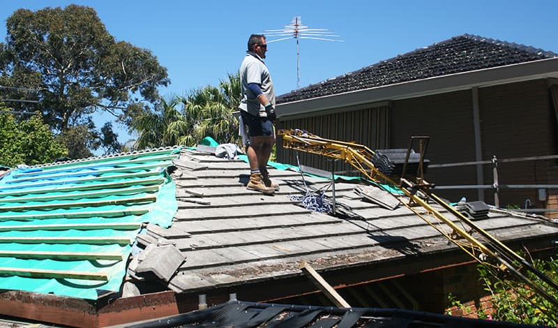 roofing specialist from WorldClass Roofing working on roof